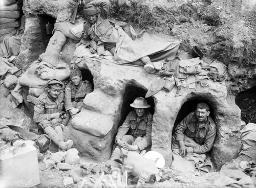Men of the Border Regiment resting in shallow dugouts near Thiepval Wood during the Battle of the Somme during August 1916.